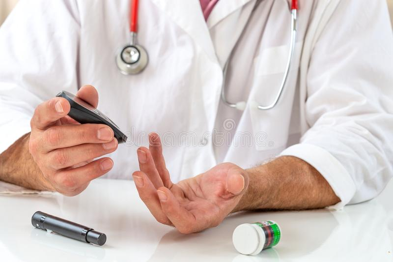 Telehealth education for diabetic patient. Doctor showing how to use medical kit for diabetes treatment royalty free stock photo