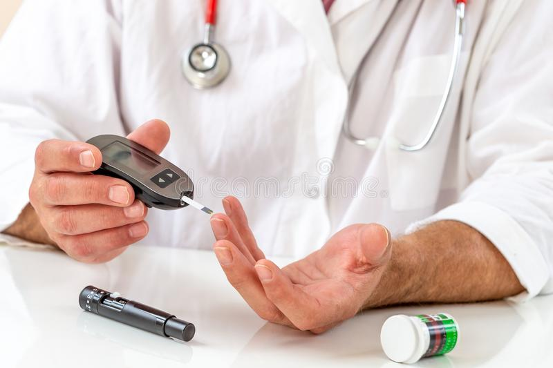 Telehealth education for diabetic patient. Doctor showing how to use medical kit for diabetes treatment stock photos