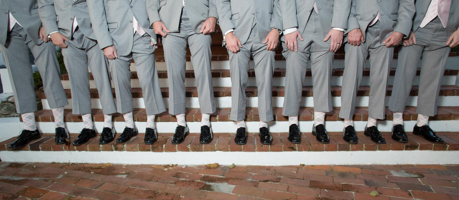 Line Of Men S Legs And Shoes Stock Image