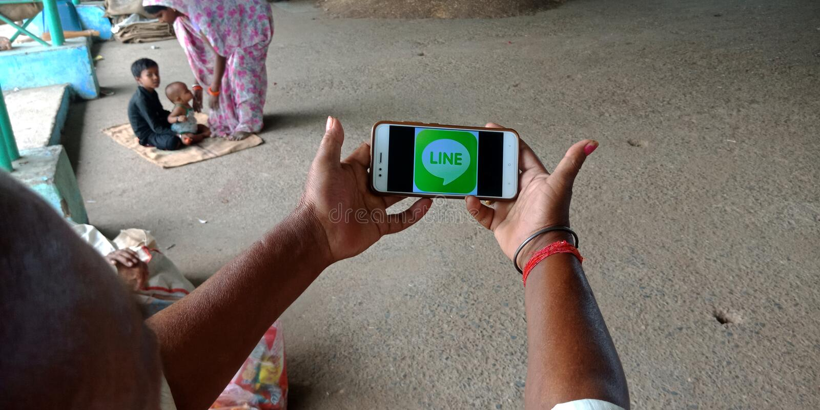 line messenger app logo displaying on mobile phone screen at agriculture produce market stock photos