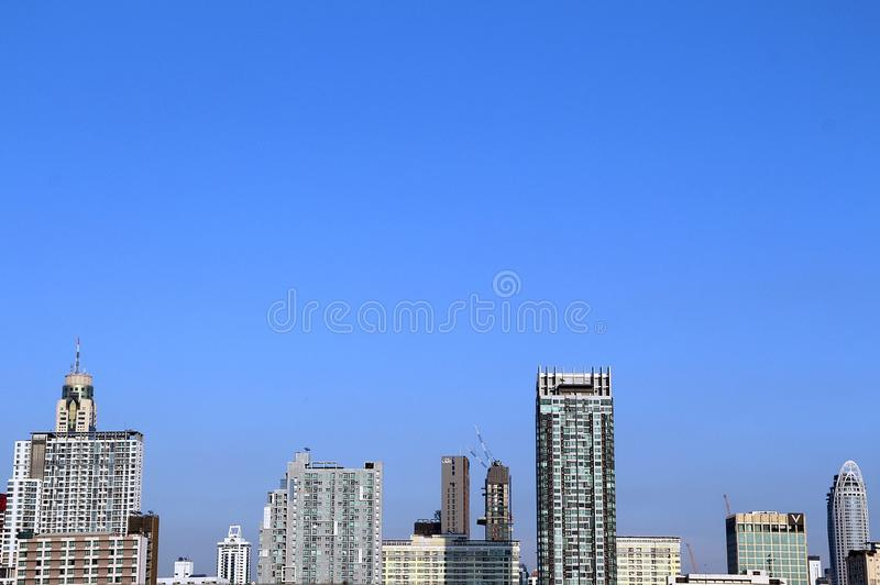 Bangkok cityscape under blue sky. Line of modern high buildings under clear blue sky stock image