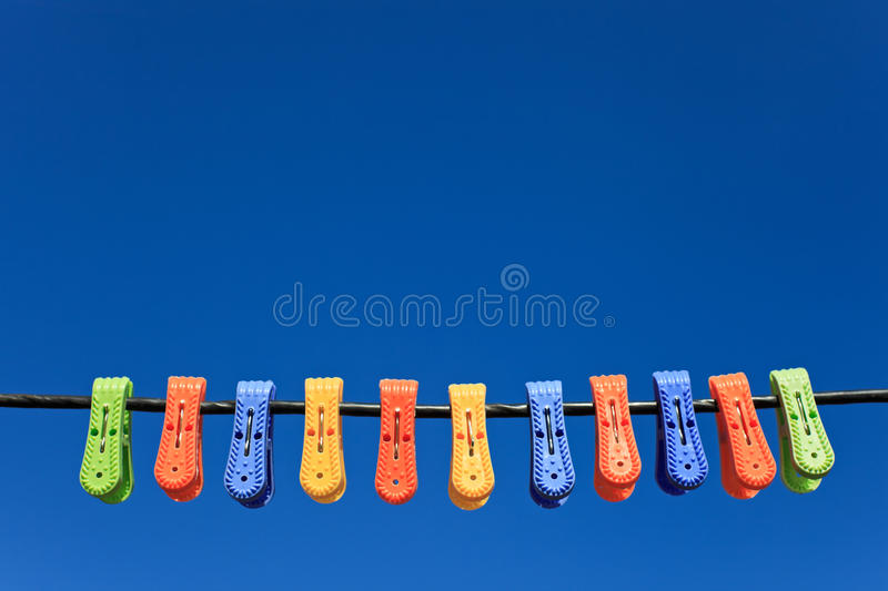 Download Line Of Multicolor Plastic Clothes Pegs Stock Image - Image: 19193139