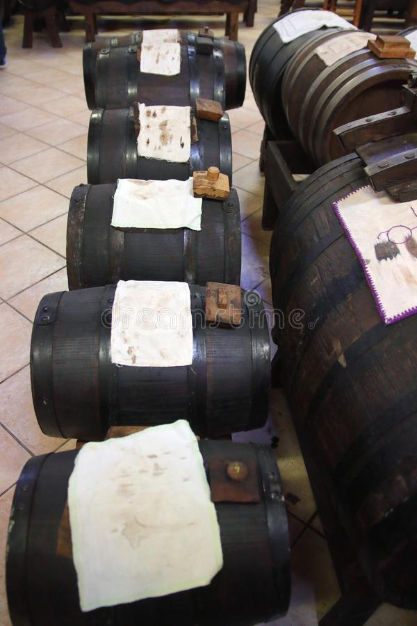 Line of old casks for the procduction of original Balsamic vinegar in Castelnuovo di Modena. `Batteria` is a series of barrels of different kind of woods for the stock image