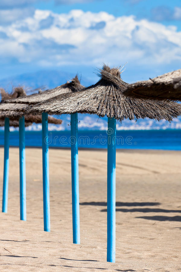 Download Line Of Parasols At Spanish Sand Beach Stock Photos - Image: 31105433