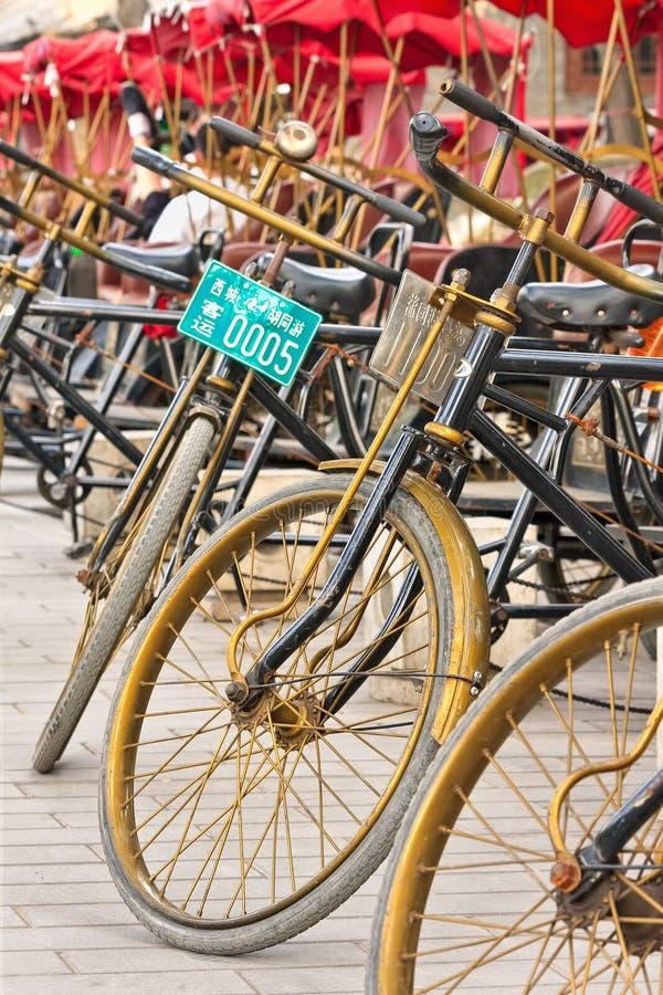 Line of parked rickshaws, Beijing, China royalty free stock image