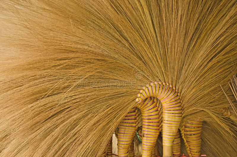 Line pattern details of grass broom close up. Yellow line pattern details of grass and tied rattan of broom close up stock photo