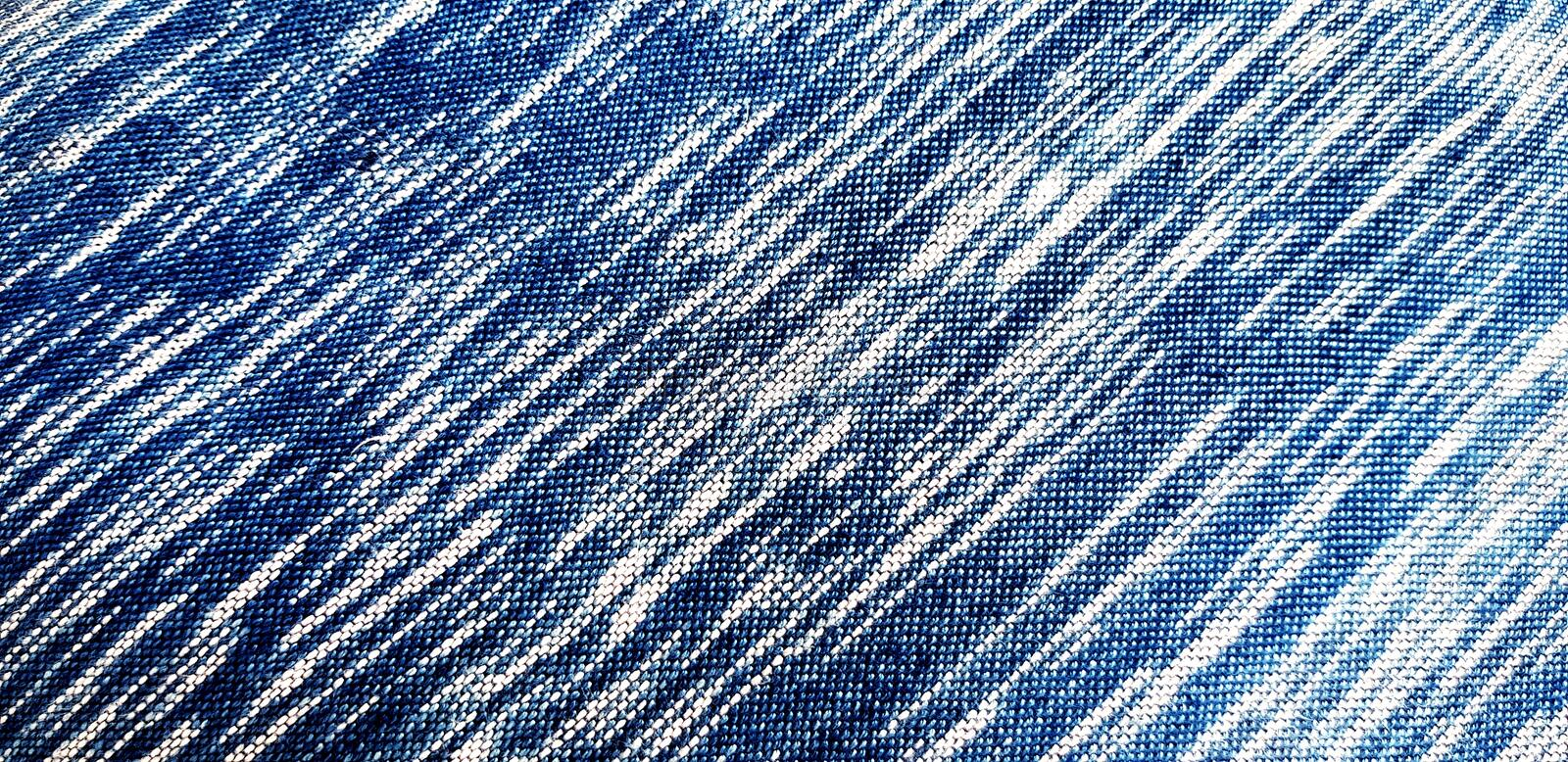 Line pattern of white and blue cotton surface for background or wallpaper royalty free stock photos
