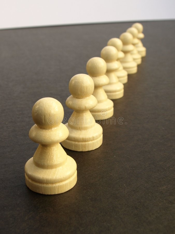 Line Of Pawns Royalty Free Stock Photography