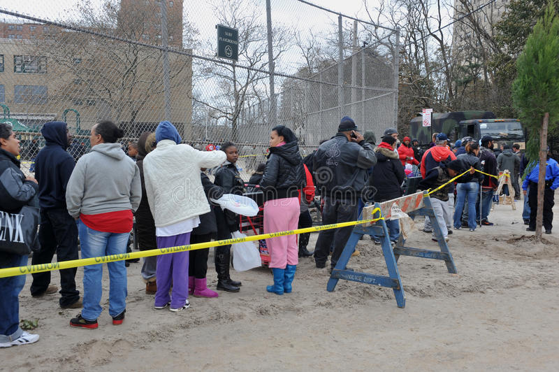 Line of people for free food and water stock photo