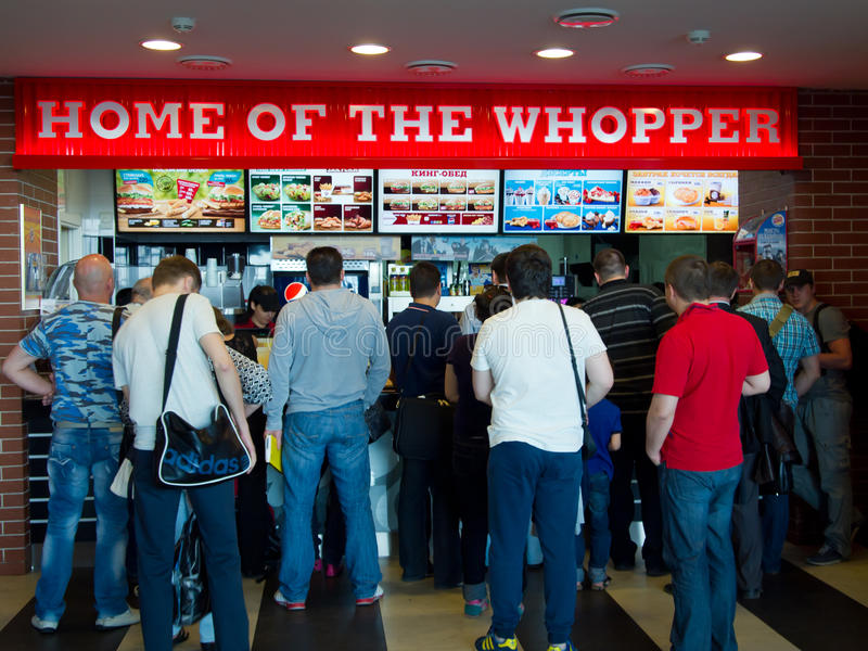 Line of people standing in a cafe Burger King at the airport Vnukovo, Moscow stock image