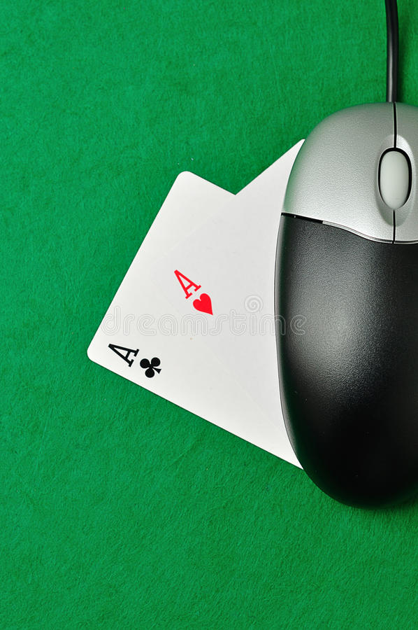 On line poker. A computer mouse and 2 ace cards symbolizing on line poker royalty free stock photos