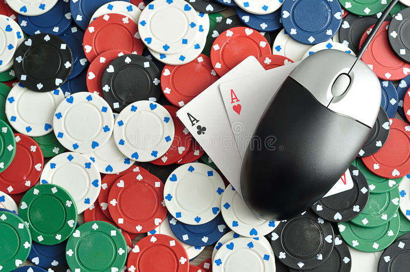 On line poker. A computer mouse with poker chips and 2 ace cards symbolizing on line poker stock image