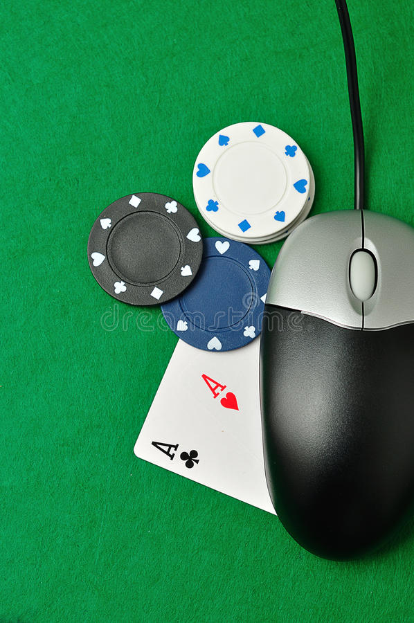 On line poker. A computer mouse with poker chips and 2 ace cards symbolizing on line poker royalty free stock image