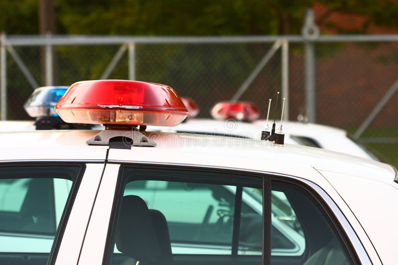 Line of police sirens. Side view of row of police sirens royalty free stock photography