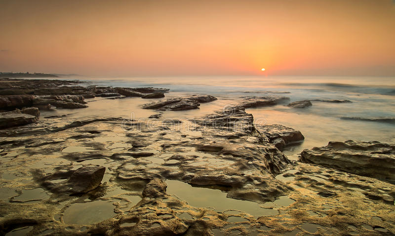 Line of rocks to rising sun. This photo was taken in Kwazulu Natal, South Africa royalty free stock photography