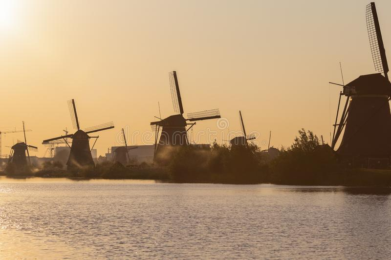 Line of Romantic and Traditional Dutch Windmills in Kinderdijk Village in the Netherlands. Picture taken During Golden Hour. Horizontal Image royalty free stock images