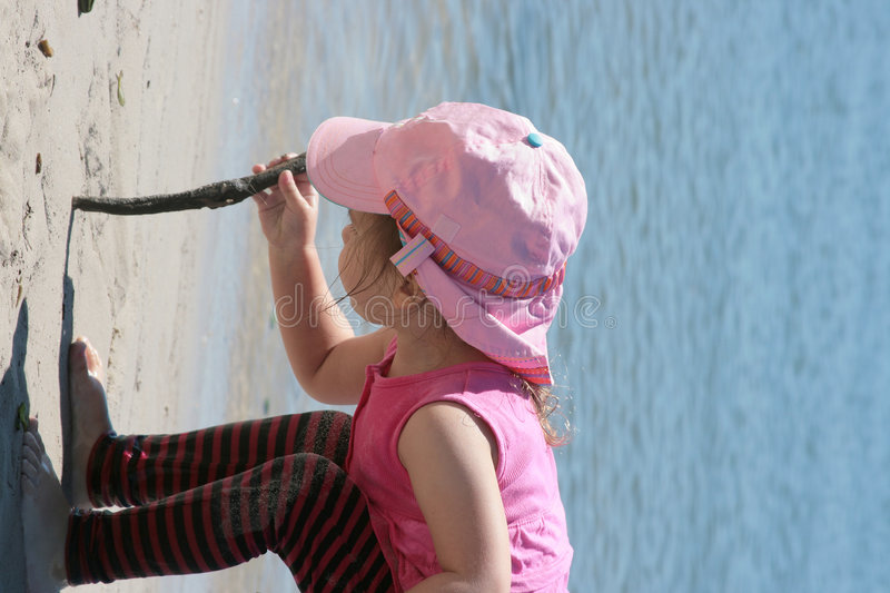Download Line in the Sand stock photo. Image of child, stick, ocean - 3372566