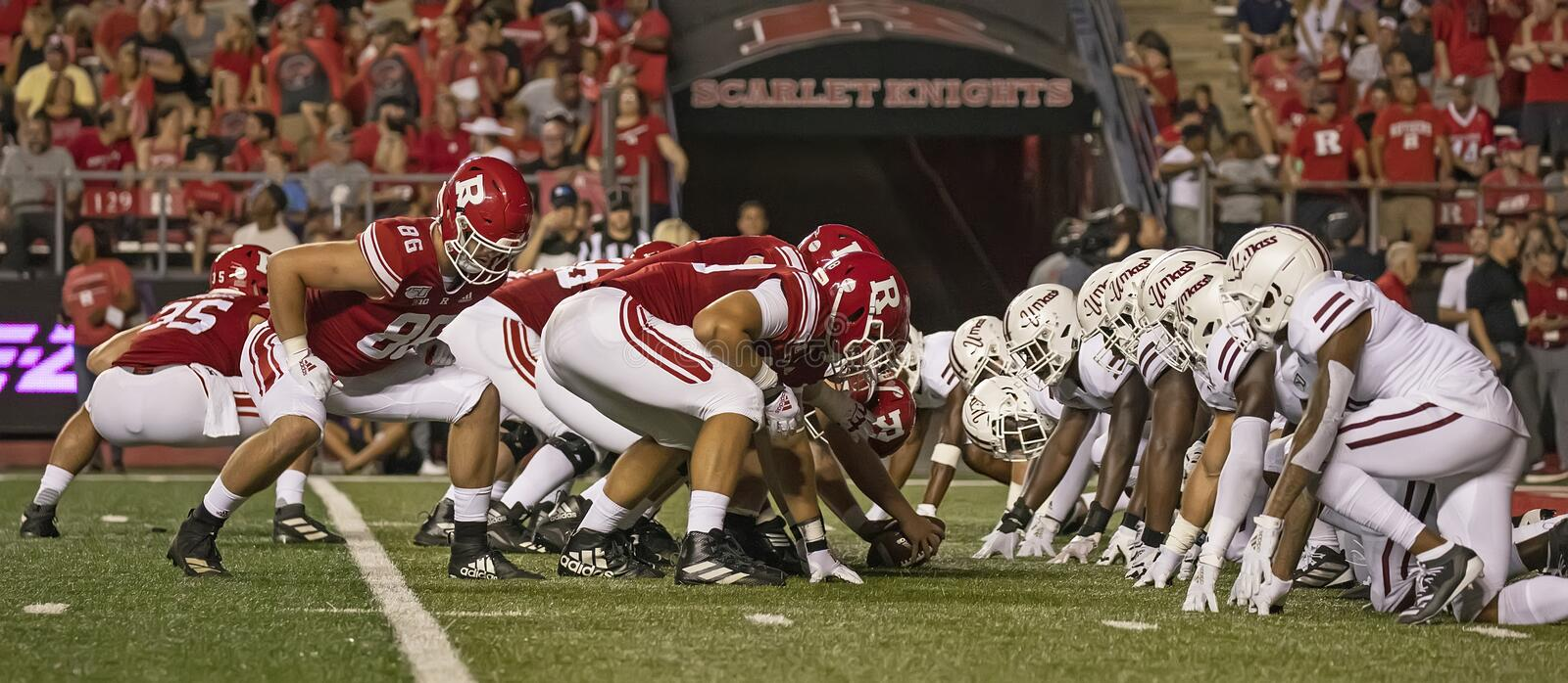 Rutgers Celebrates 150 Years of Intercollegiate Football. Line of scrimmage ground view as Rutgers prepares to kick an extra point after touchdown.  against the royalty free stock photo