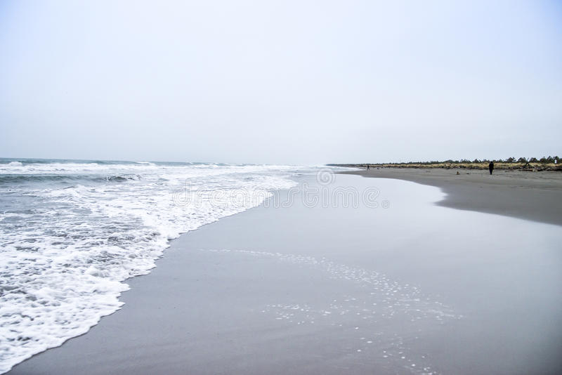 The line of the sea. Tuscany beach in winter with the sea that is pointing the horizon royalty free stock images
