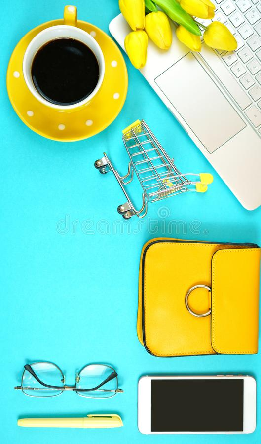 On-line shopping concept flatlay with shopping cart and accessories. Online shopping concept with laptop, shopping cart, smart phone, calculator, coffee and royalty free stock photos