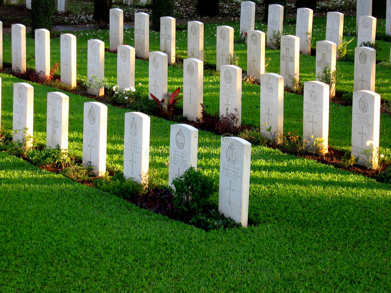 Line of Tombstones. Tombstones stand in a line in a beautiful cemetery in Pune, India royalty free stock images