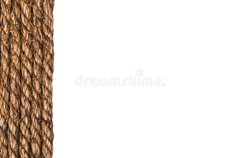 Line of a twisted decorational linen rope string isolated on white background. Empty space. Copy space royalty free stock photography