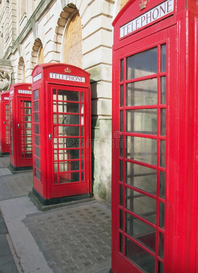 Line of typical old fashioned british red public telephone boxes outside the former post office in Blackpool Lancashire royalty free stock images