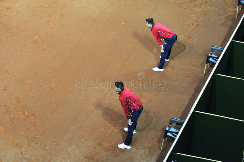 Line umpire in action during a tennis match royalty free stock images