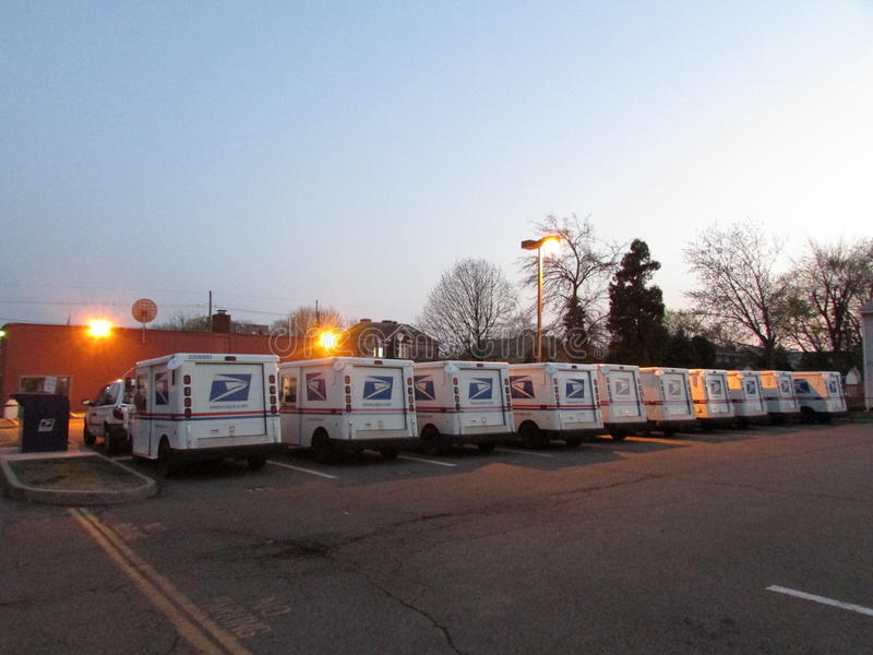 Line of USPS mail delivery trucks in Edison, NJ, USA. Parking lot with United States Postal Service mail delivery trucks at dusk stock photos