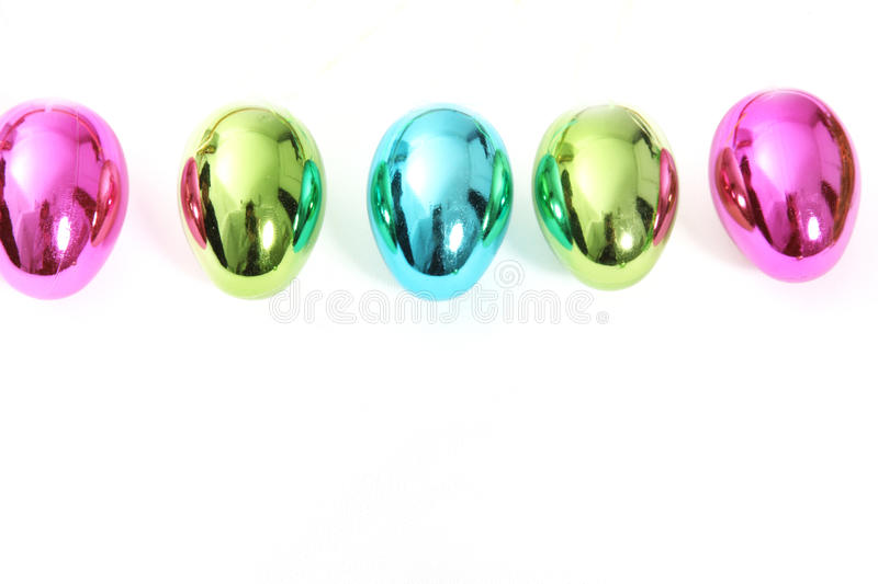Line of vibrant shiny Easter Eggs royalty free stock image