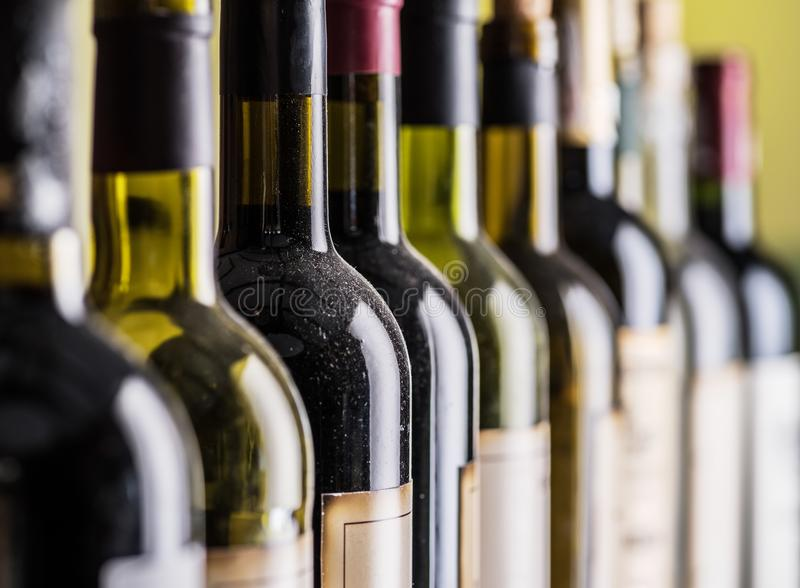 Line of wine bottles. Close-up. royalty free stock image