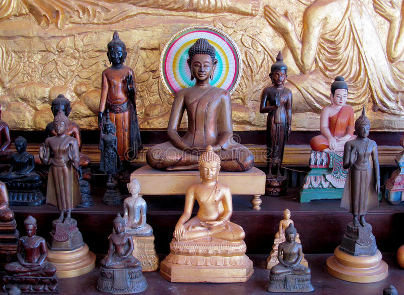 Line of wooden buddha statues stock image