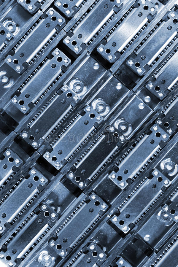 Linear ball bearings - blue tinted industrial background.  stock photos