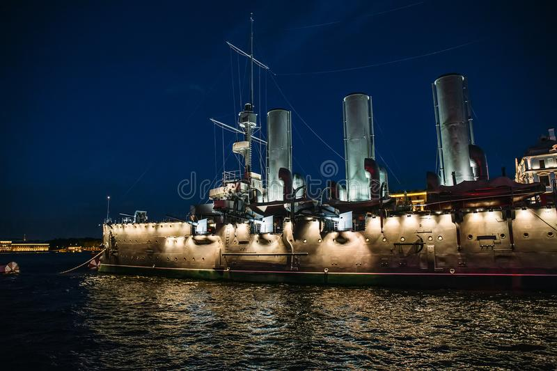 Linear cruiser Aurora or Avrora at night, the symbol of the October revolution in Russia. St. Petersburg royalty free stock photo