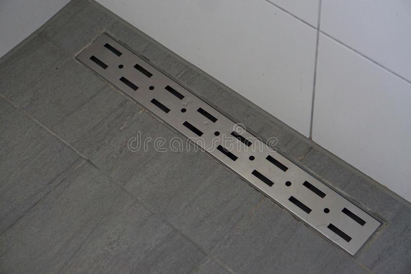 Linear floor level shower. Image design stock photography