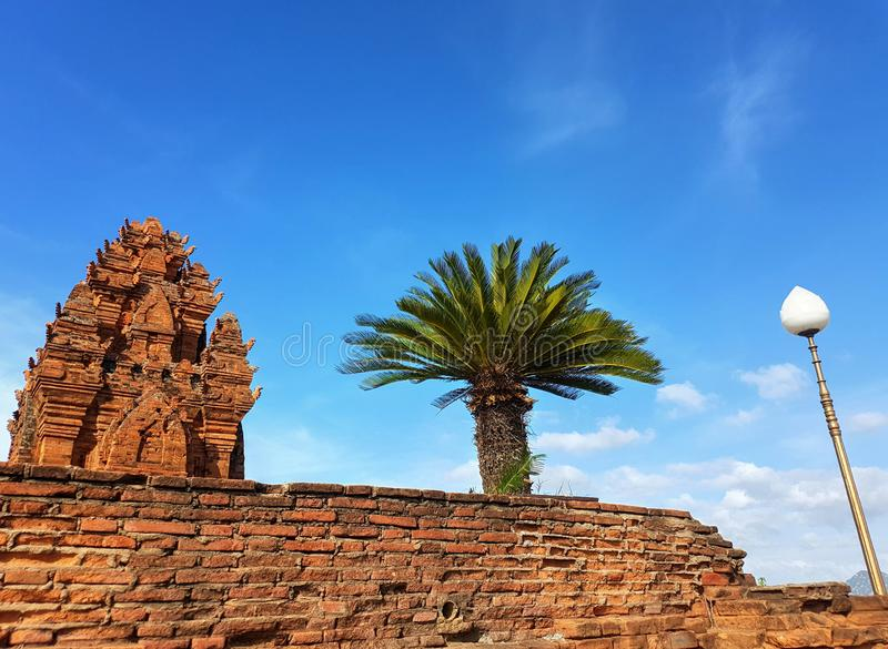 Linear harmony. Of ruins palm tree and lamp post in gorgeous vietnam stock image