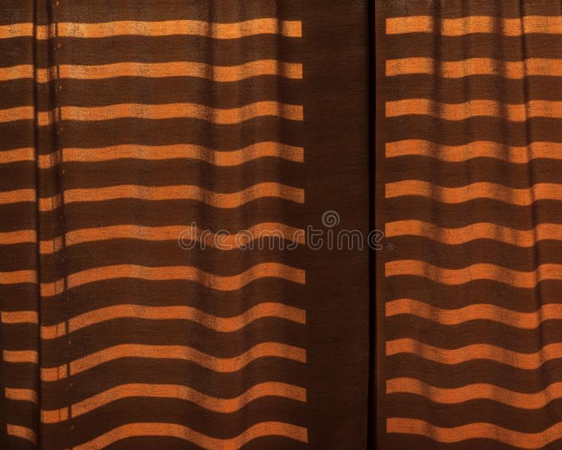 Linear shadows projected onto curtains. By sunlight royalty free stock photo