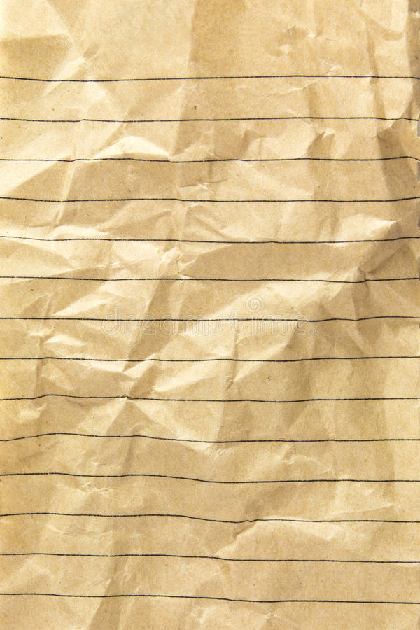 Lined sheet. Rumpled lined sheet of recycle paper isolated on white background stock image