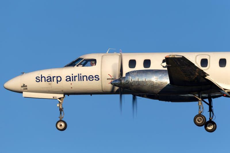 Linee aeree taglienti Fairchild SA-227 Metroliner VH-MYI sull'approccio a terra ad Adelaide Airport immagini stock libere da diritti