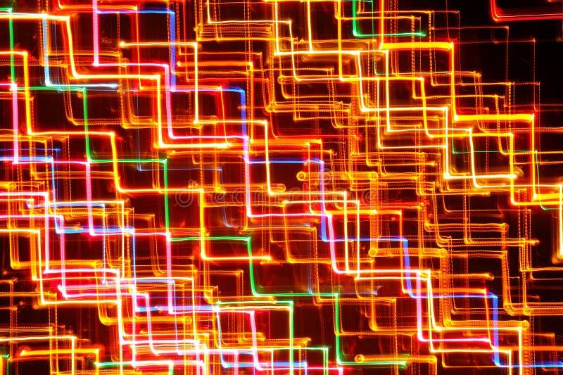 Linee d'ardore luminose astratte come fondo immagine stock