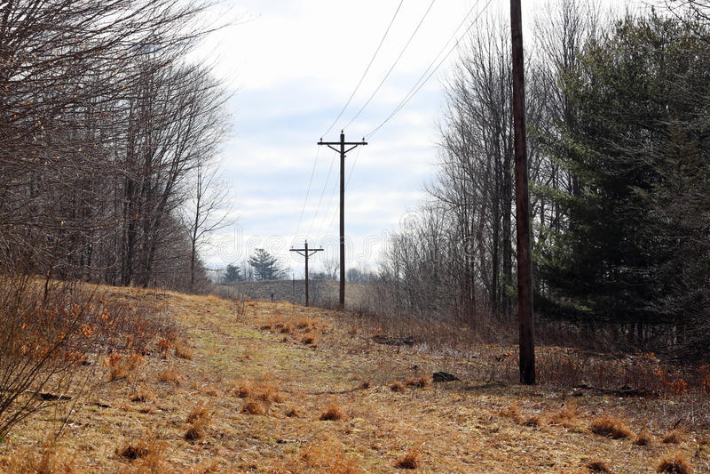 Linee elettriche su una collina fotografia stock libera da diritti