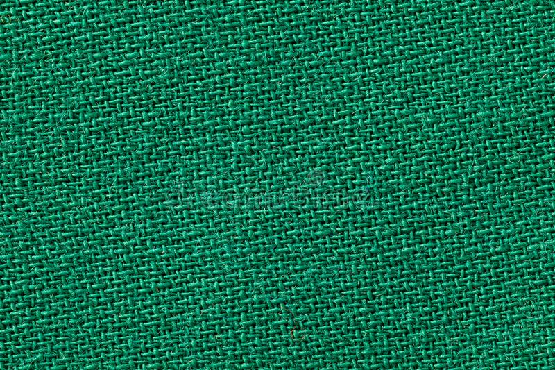 The linen cloth in green color. Fabric background texture. Detail of textile material close-up royalty free stock photo