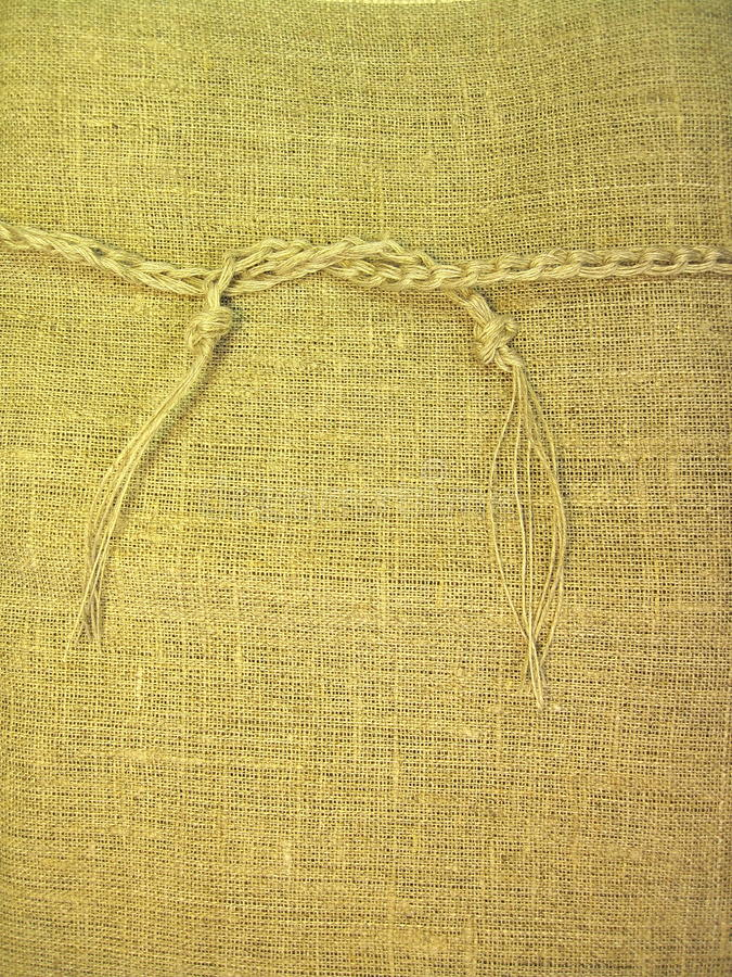Linen fabric. With string suitable as background royalty free stock photos