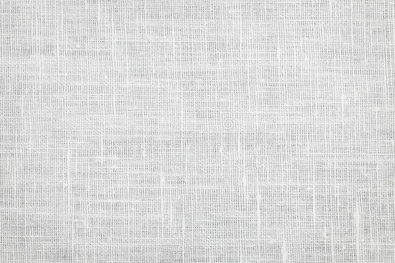 Linen fabric background. White linen woven fabric background or texture royalty free stock image