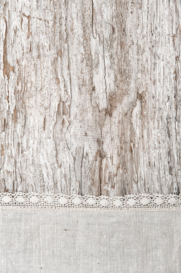Download Linen Fabric With Lace On The Old Wooden Background Stock Image