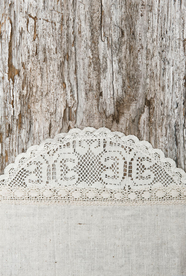 Download Linen Fabric With Lace On The Old Wooden Background Stock Photo