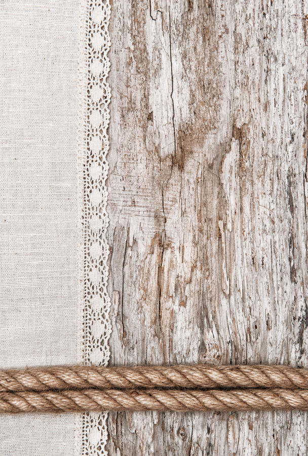 Download Linen Fabric With Lace And Rope On The Old Wood Stock Image