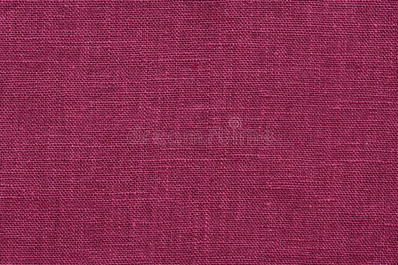 Linen fabric texture. Dark purple rough linen fabric texture close-up as background stock photography