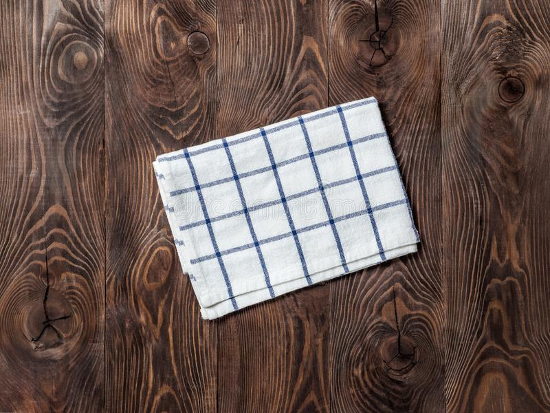 Linen napkin on wooden table, top view, mock up royalty free stock photo