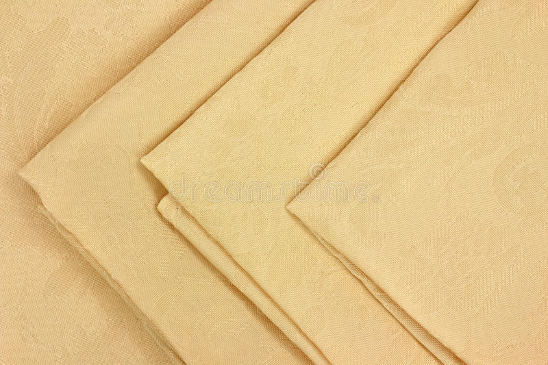 Linen napkins. Close view of tan cloth folded linen napkins stock photos